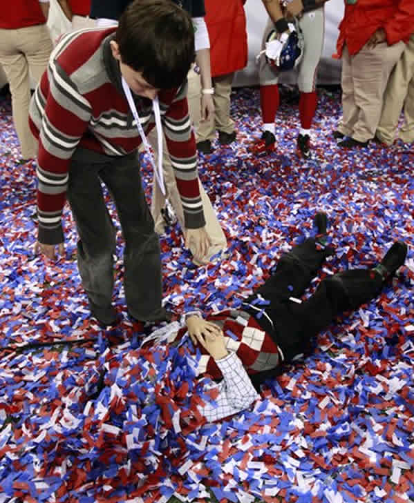 Children play in the confetti on the field after the NFL Super Bowl XLVI football game Sunday, Feb. 5, 2012, in Indianapolis. The Giants won 21-17. (AP Photo/Jeff Roberson)