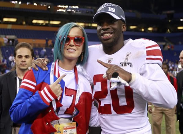New York Giants defensive back Prince Amukamara (20) celebrates with pop star Katy Perry after the Giants' 21-17 win in the NFL Super Bowl XLVI football game against the New England Patriots Sunday, Feb. 5, 2012, in Indianapolis. (AP Photo/Jeff Roberson)