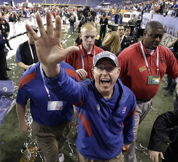 New York Giants head coach Tom Coughlin waves as he walks off the field after his team's 21-17 victory over the New England Patriots in the NFL Super Bowl XLVI football game, Sunday, Feb. 5, 2012, in Indianapolis. (AP Photo/David J. Phillip)