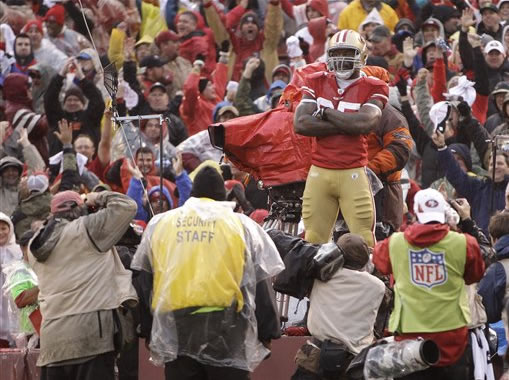San Francisco 49ers' Vernon Davis poses for a picture after catching a 73-yard touchdown pass during the first half of the NFC Championship NFL football game against the New York Giants Sunday, Jan. 22, 2012, in San Francisco. (AP Photo/Paul Sakuma)