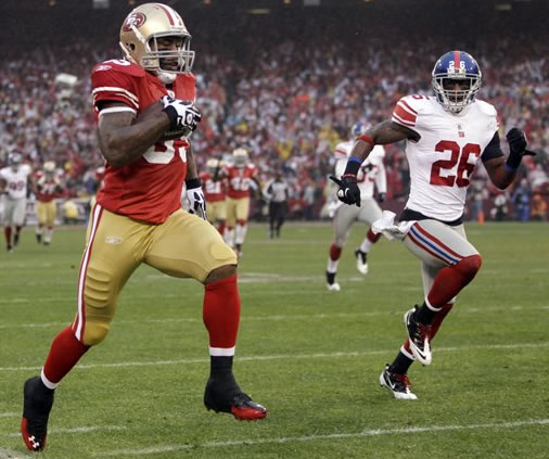 "<div class=""meta image-caption""><div class=""origin-logo origin-image ""><span></span></div><span class=""caption-text"">San Francisco 49ers' Vernon Davis (85) stays in bounds as run runs past New York Giants' Antrel Rolle (26) for a 73-yard touchdown reception during the first half of the NFC Championship NFL football game Sunday, Jan. 22, 2012, in San Francisco. (AP Photo/Paul Sakuma)</span></div>"