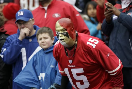 Fans watch teams warm up before the NFC championship NFL football game between the San Francisco 49ers and the New York Giants Sunday, Jan. 22, 2012, in San Francisco. (AP Photo/David J. Phillip)