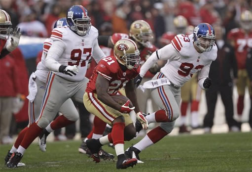 "<div class=""meta ""><span class=""caption-text "">San Francisco 49ers running back Frank Gore (21) runs against New York Giants defensive tackle Linval Joseph (97) and middle linebacker Chase Blackburn (93) during the first half of the NFC Championship NFL football game Sunday, Jan. 22, 2012, in San Francisco. (AP Photo/David J. Phillip)</span></div>"