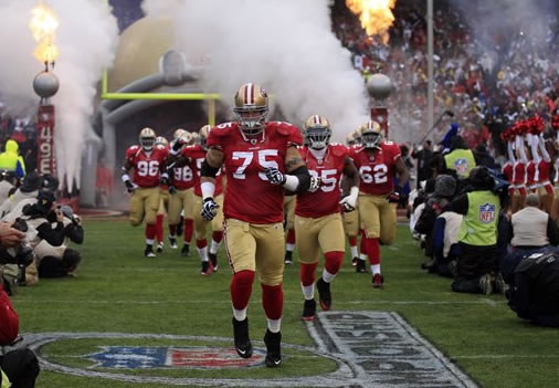 The San Francisco 49ers are introduced before the NFC Championship NFL football game Sunday, Jan. 22, 2012, in San Francisco. (AP Photo/Marcio Jose Sanchez)