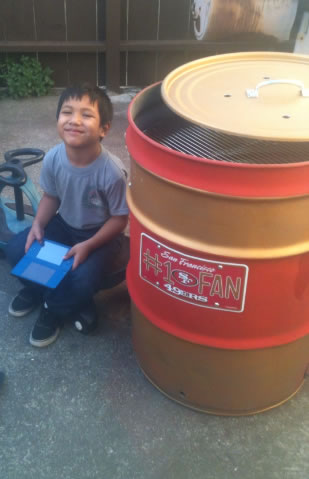 "<div class=""meta ""><span class=""caption-text "">Forty Niners Number One Fan & His Homemade Smoker. (Photo submitted by via uReport)</span></div>"