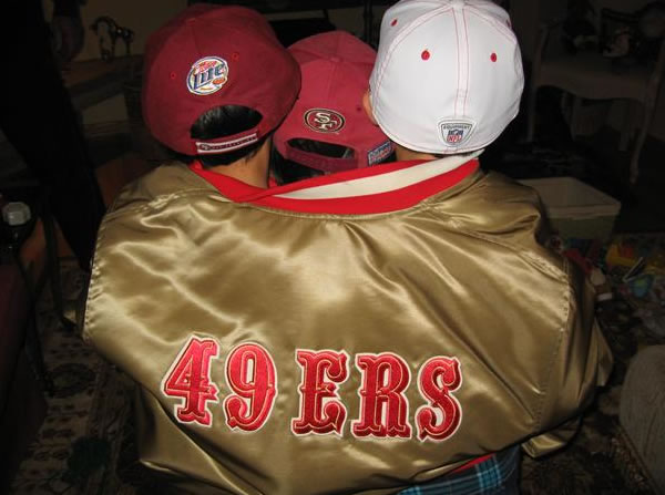 "<div class=""meta ""><span class=""caption-text "">Little fans Sean, Nolan and Shauna in Nonno Joe's 49er jacket. (Photo submitted by Julie Collins from Santa Rosa via uReport)</span></div>"