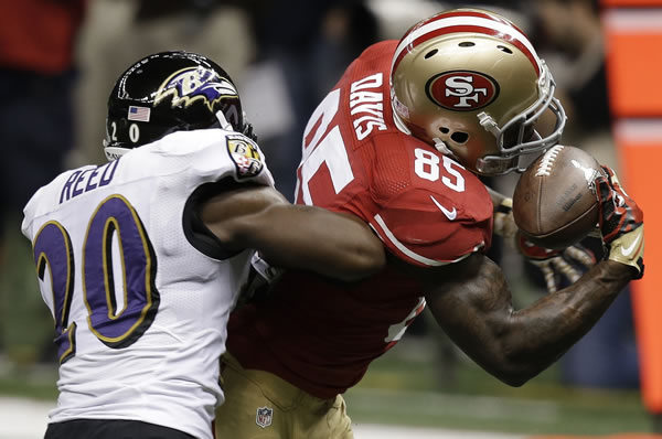 San Francisco 49ers tight end Vernon Davis (85) makes a catch against Baltimore Ravens safety Ed Reed (20) during the first half of the NFL Super Bowl XLVII football game, Sunday, Feb. 3, 2013, in New Orleans. (AP Photo/Gene Puskar)