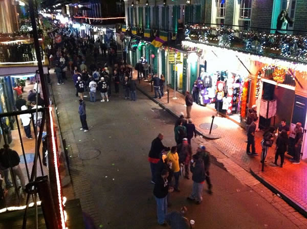 "<div class=""meta ""><span class=""caption-text "">Here's the view from a Bourbon Street balcony. @WayneFreedman is getting ready for his live shot. </span></div>"