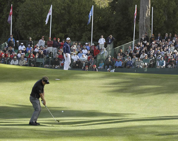 Luke Donald, of England, hits a shot on the 17th hole during the first round of the U.S. Open Championship golf tournament Thursday, June 14, 2012, at The Olympic Club in San Francisco. (AP Photo/Charlie Riedel)