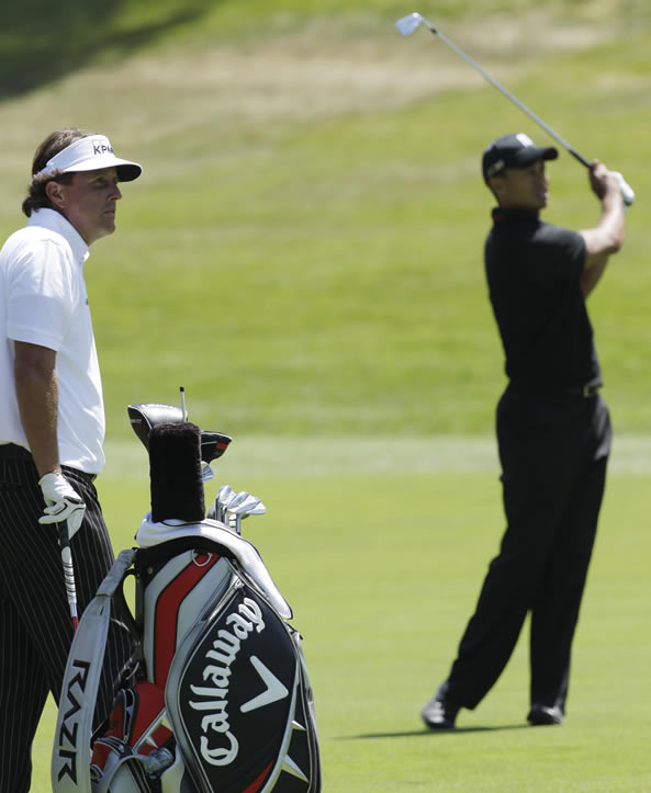 Phil Mickelson and Tiger Woods during the second round of the U.S. Open Championship golf tournament Friday, June 15, 2012, at The Olympic Club in San Francisco. (AP Photo/Ben Margot)