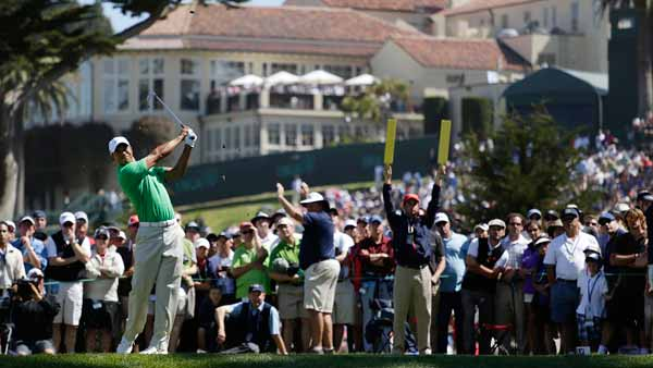 Tiger Woods hits a drive on the fourth hole during the third round of the U.S. Open Championship golf tournament Saturday, June 16, 2012, at The Olympic Club in San Francisco. (AP Photo/Eric Gay)