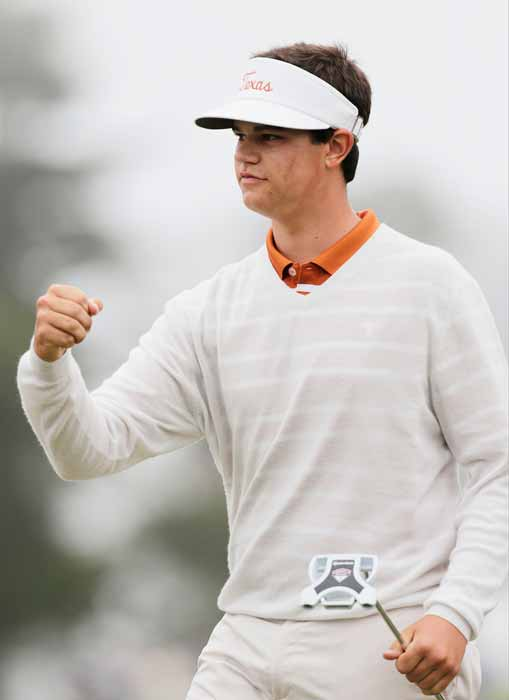 Amateur Beau Hossler reacts after chipping in to...