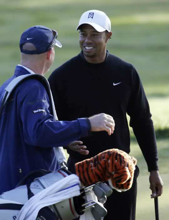Tiger Woods talks to his caddie Joe LaCava on the ninth hole during a practice round for the U.S. Open Championship golf tournament Monday, June 11, 2012, in San Francisco. (AP Photo/Morry Gash)