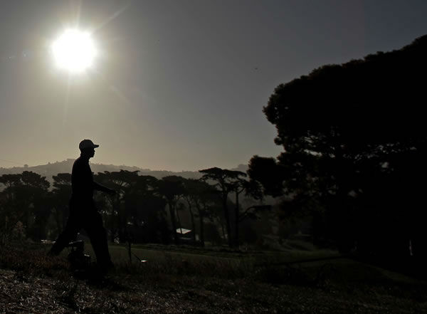 Tiger Woods makes his way to the third hole during a practice round for the U.S. Open Championship golf tournament Tuesday, June 12, 2012, at The Olympic Club in San Francisco. (AP Photo/Charlie Riedel)