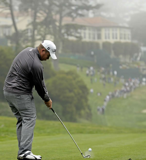 George Coetzee, of South Africa, hits a shot on the 18th hole during a practice round for the U.S. Open Championship golf tournament Wednesday, June 13, 2012, at The Olympic Club in San Francisco. (AP Photo/Charlie Riedel)