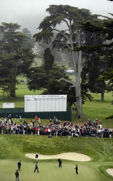 Tiger Woods and Casey Martin putt on the 18th hole during a practice round for the U.S. Open Championship golf tournament Wednesday, June 13, 2012, at The Olympic Club in San Francisco. (AP Photo/Charlie Riedel)
