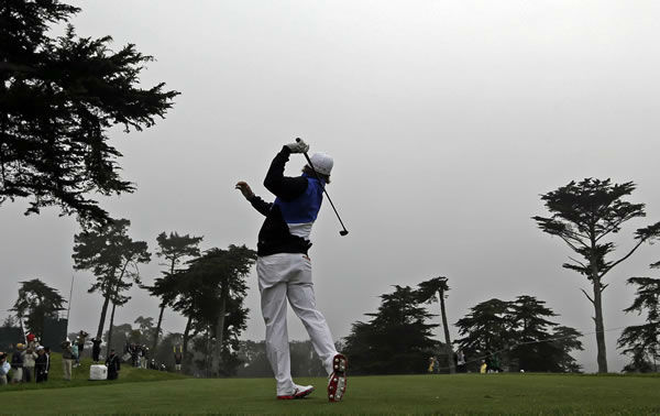 Rickie Fowler hits a drive on the fourth holeduring a practice round for the U.S. Open Championship golf tournament Wednesday, June 13, 2012, at The Olympic Club in San Francisco. (AP Photo/David J. Phillip)