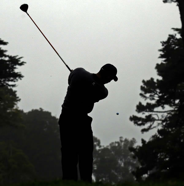 Tiger Woods hits a drive on the 12th hole during a practice round for the U.S. Open Championship golf tournament Wednesday, June 13, 2012, at The Olympic Club in San Francisco. (AP Photo/Charlie Riedel)