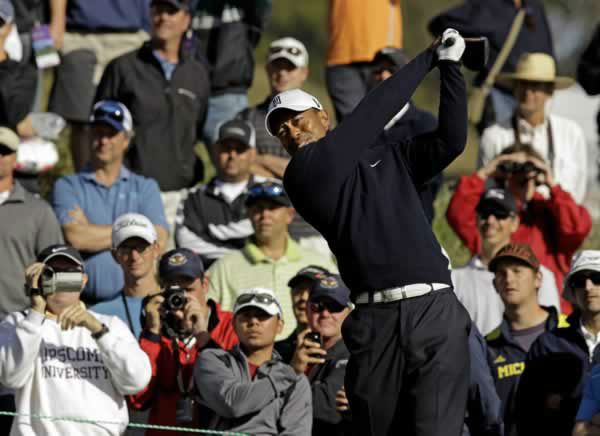 Tiger Woods hits a drive on the sixth hole during a practice round for the U.S. Open Championship golf tournament Tuesday, June 12, 2012, at The Olympic Club in San Francisco. (AP Photo/Charlie Riedel)