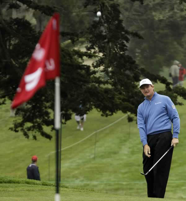 Ernie Els, of South Africa, chips up to the 11th green during a practice round for the U.S. Open Championship golf tournament Wednesday, June 13, 2012, at The Olympic Club in San Francisco. (AP Photo/Charlie Riedel)