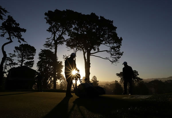 Workers mow the 7th green at The Olympic Club before a practice round for the U.S. Open Championship golf tournament Monday, June 11, 2012, in San Francisco. (AP Photo/Morry Gash)
