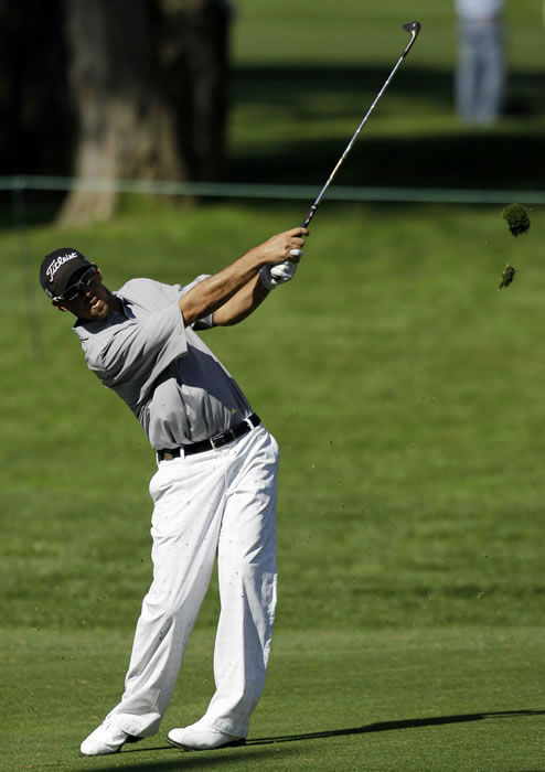 Cole Howard hits a shot on the 10th hole during a practice round for the U.S. Open Championship golf tournament Tuesday, June 12, 2012, at The Olympic Club in San Francisco. (AP Photo/Eric Gay)