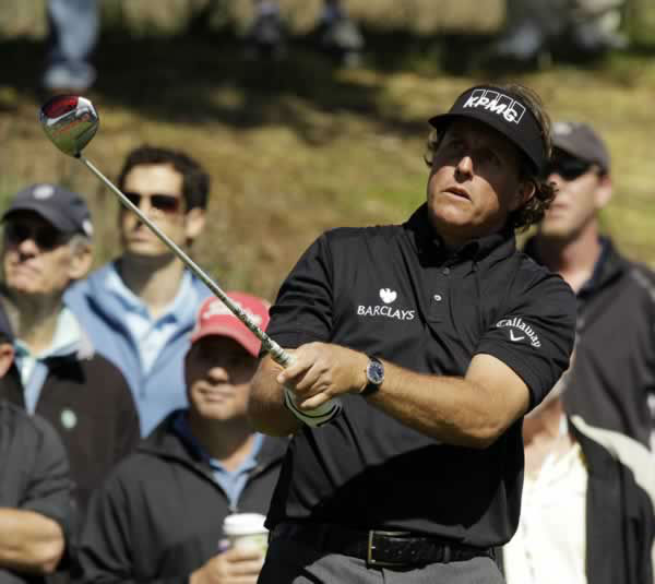 Phil Mickelson hits a drive on the sixth hole during a practice round for the U.S. Open Championship golf tournament Tuesday, June 12, 2012, at The Olympic Club in San Francisco. (AP Photo/Charlie Riedel)
