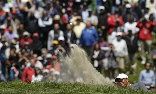 Tiger Woods hits out of a bunker on the sixth hole during the first round of the U.S. Open Championship golf tournament Thursday, June 14, 2012, at The Olympic Club in San Francisco. (AP Photo/Charlie Riedel)