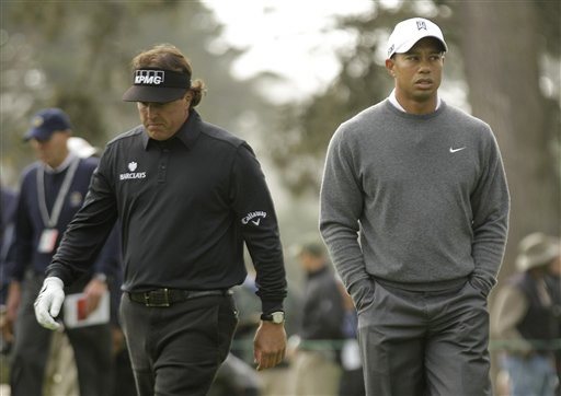 Tiger Woods and Phil Mickelson during the first round of the U.S. Open Championship golf tournament Thursday, June 14, 2012, at The Olympic Club in San Francisco. (AP Photo/Charlie Riedel)