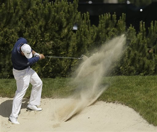 Lee Westwood, of England, hits out of a bunker on the sixth hole during the first round of the U.S. Open Championship golf tournament Thursday, June 14, 2012, at The Olympic Club in San Francisco. (AP Photo/Charlie Riedel)