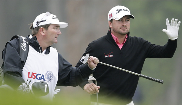Graeme McDowell, of Northern Ireland, waves to...