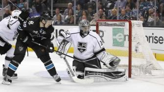 Los Angeles Kings goalie Jonathan Quick (32) blocks a goal attempt by San Jose Sharks center Logan Couture