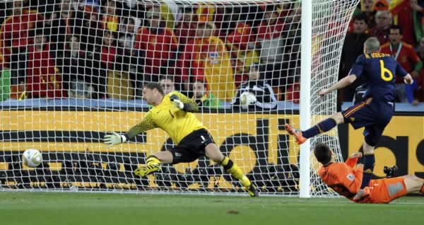 Spain's Andres Iniesta, right, scores a goal past Netherlands goalkeeper Maarten Stekelenburg, left, during the World Cup final soccer match between the Netherlands and Spain at Soccer City in Johannesburg, South Africa, Sunday, July 11, 2010. (AP Photo/Daniel Ochoa de Olza)
