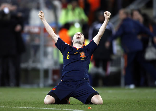 Spain's Andres Iniesta celebrates after scoring a goal during the World Cup final soccer match between the Netherlands and Spain at Soccer City in Johannesburg, South