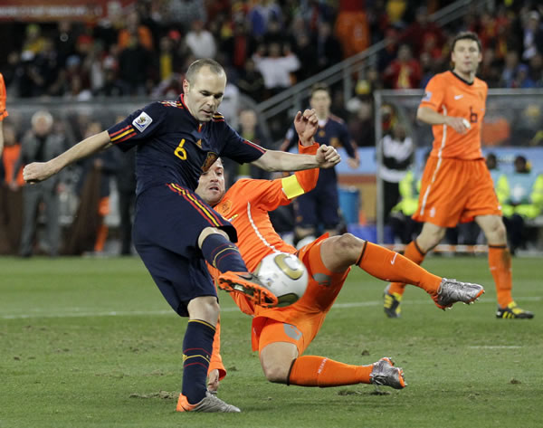 Spain's Andres Iniesta, left, scores a goal past Netherlands' Rafael van der Vaart during the World Cup final soccer match between the Netherlands and Spain at Soccer City in Johannesburg, South Africa, Sunday, July 11, 2010. (AP Photo/Martin Meissner)