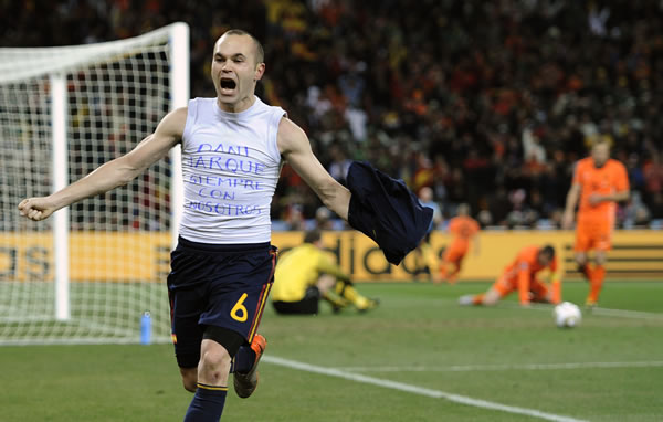 "Spain's Andres Iniesta celebrates after scoring a goal, with the words ""Dani Jarque, always with us"", written on his undershirt, during the World Cup final soccer match between the Netherlands and Spain at Soccer City in Johannesburg, South Africa, Sunday, July 11, 2010. (AP Photo/Hassan Ammar)"