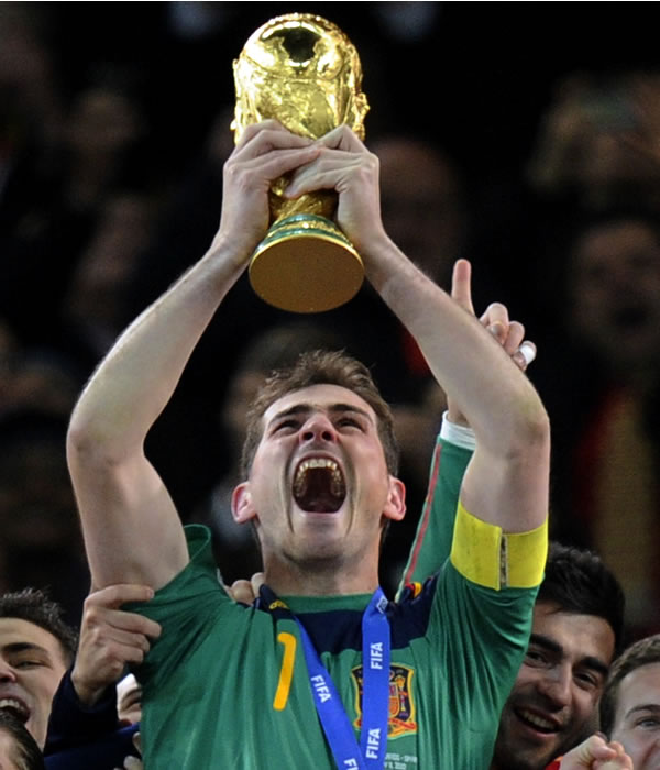 Spain goalkeeper Iker Casillas holds up the World Cup trophy after the World Cup final soccer match between the Netherlands and Spain at Soccer City in Johannesburg, South Africa, Sunday, July 11, 2010. Spain won 1-0. (AP Photo/Martin Meissner)