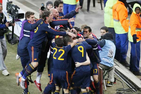 Spain players react after a 1-0 victory over the Netherlands during the final soccer match of the World Cup at Soccer City stadium in Johannesburg, South Africa, Sunday, July 11, 2010, to win its first World Cup title. (AP Photo/Eugene Hoshiko)
