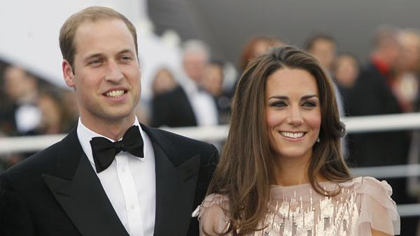Britain's Prince William, left, and his wife Kate, Duchess of Cambridge, arrive at a charity event for Absolute Return for Kids, ARK, in central London.