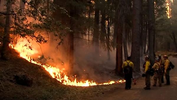 A giant wildfire raging out of control spread into Yosemite on Friday as authorities urged more evacuations in nearby communities.