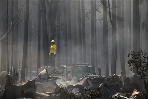 A firefighter stands on top of a fire truck at a campground destroyed by the Rim Fire near Yosemite National Park, Calif., on Monday, Aug. 26, 2013. Crews working to contain one of California&#39;s largest-ever wildfires gained some ground Monday against the flames threatening San Francisco&#39;s water supply, several towns near Yosemite National Park and historic giant sequoias. <span class=meta>(AP Photo&#47;Jae C. Hong)</span>