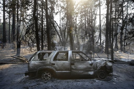A burned SUV sits in front of a campground destroyed by the Rim Fire near Yosemite National Park, Calif., on Monday, Aug. 26, 2013. Crews working to contain one of California&#39;s largest-ever wildfires gained some ground Monday against the flames threatening San Francisco&#39;s water supply, several towns near Yosemite National Park and historic giant sequoias. <span class=meta>(AP Photo&#47;Jae C. Hong)</span>