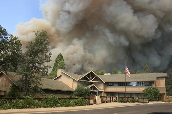In this undated photo provided by the U.S. Forest Service, the Rim Fire burns near Groveland Ranger Station in Groveland, Calif. The wildfire outside Yosemite National Park ? one of more than 50 major brush blazes burning across the western U.S. ? more than tripled in size overnight and still threatens about 2,500 homes, hotels and camp buildings. Fire officials said the blaze burning in remote, steep terrain had grown to more than 84 square miles and was only 2 percent contained on Thursday, down from 5 percent a day earlier. (AP Photo/U.S. Forest Service)