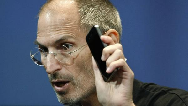 Apple CEO Steve Jobs holds up iPhone 4 as he talks about the Apple iPhone 4 at Apple headquarters in Cupertino, Calif.