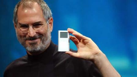 FILE - Apple CEO Steve Jobs displays his companys new product, the Mini-Ipod, at the Macworld Conference and Expo in San Francisco, Tuesday, Jan. 6, 2004. (AP Photo/Marcio Jose Sanchez)