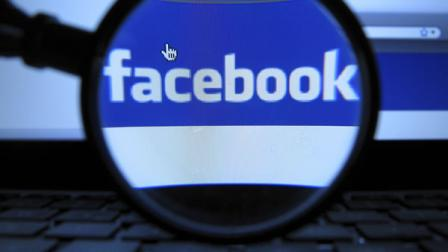 This Oct. 11, 2010 file photo, shows the logo of the online network Facebook, recorded in Munich with a magnifying glass of a computer screen of a laptop. (AP Photo/dapd, Joerg Koch)