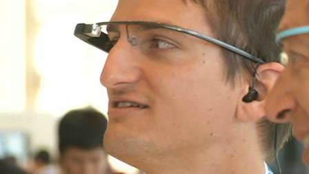 Google gave a select group of developers their first look at its new high-tech glasses Monday at an event wrapped in a cloak of secrecy.