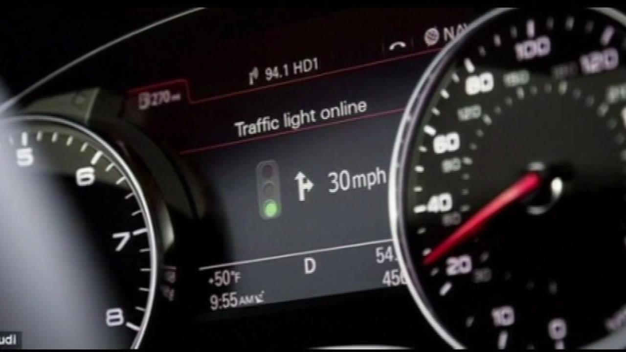 Audi is developing a smart dashboard that maps out nearby traffic signals.