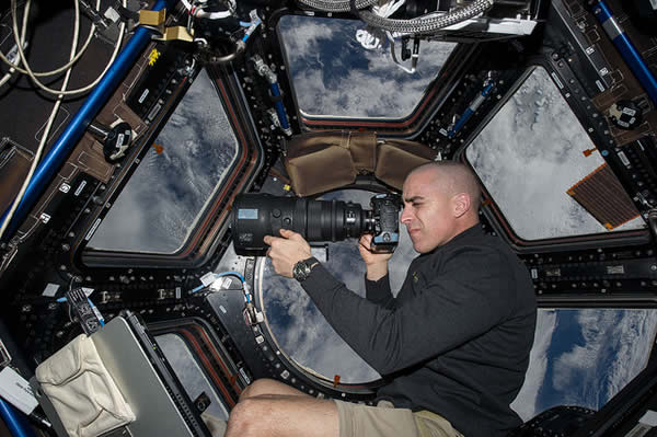 Expedition 36 Flight Engineer Chris Cassidy takes a photo aboard the International Space Station.    <span class=meta>(NASA)</span>