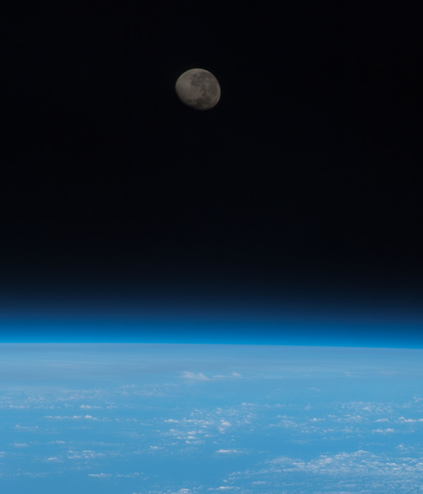 One of the Expedition 36 crew members aboard the Earth-orbiting International Space Station captured this image of a waning gibbous moon from a point 225 miles above a position on Earth located near the Equator and the Atlantic coast of northern Africa. <span class=meta>(NASA)</span>